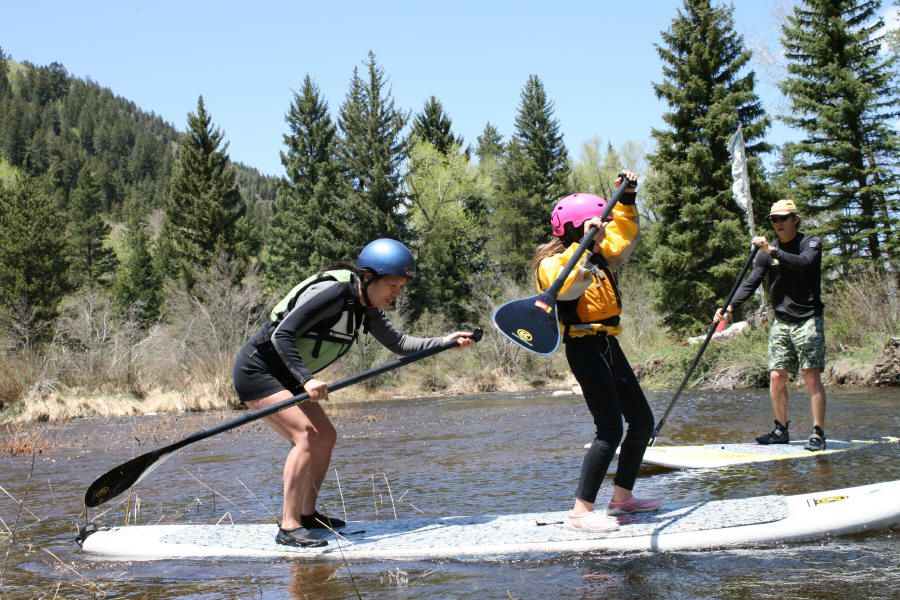 Stand Up Paddleboarding on a river. Photo courtesy of Aspen Kayak Academy.