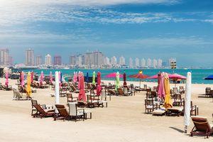 The public beach at Katara Cultural center in Doha, Qatar with closed, colorful beach umbrellas
