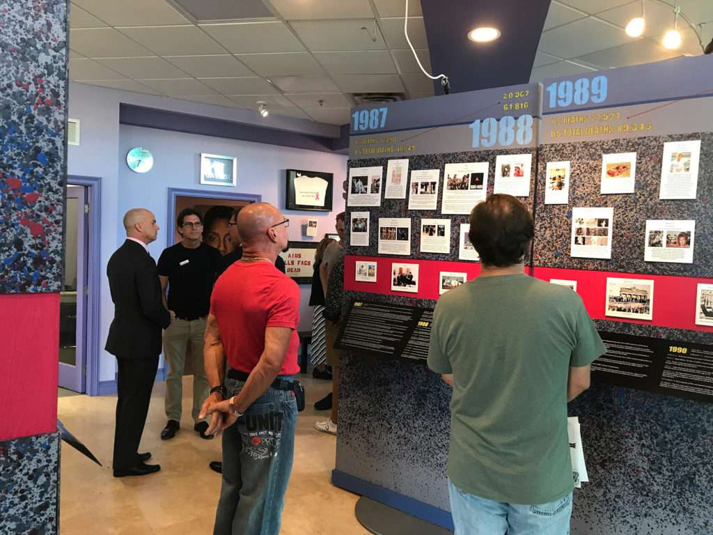People viewing the UNMASKED Exhibit
