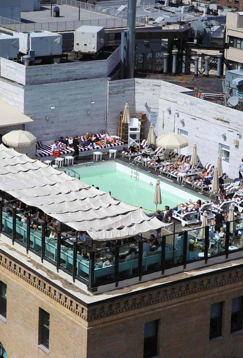 Bird's eye view of the rooftop pool of the Soho House New York, on 9th Avenue in the Meatpacking District, Manhattan, New York City