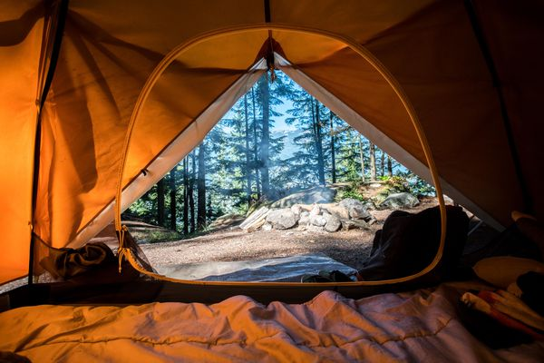View from inside a tent on a campground