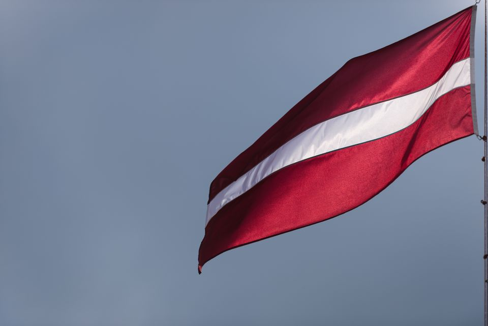 Flag Of Latvia Against Clear Sky