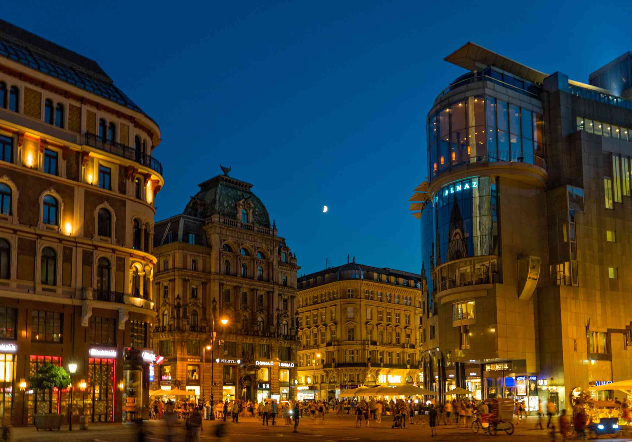 streets of vienna with old and modern buildings at night