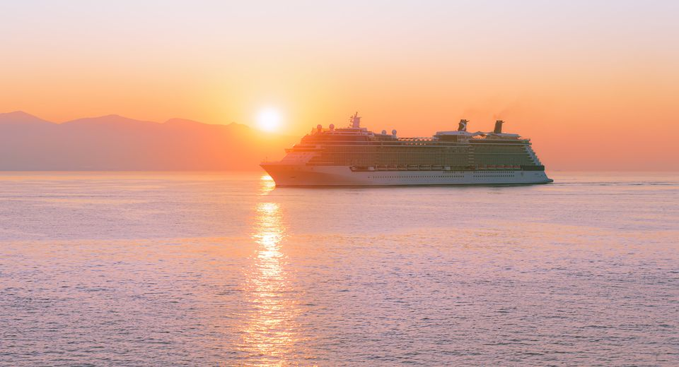 Cruise ship at sea at sunrise