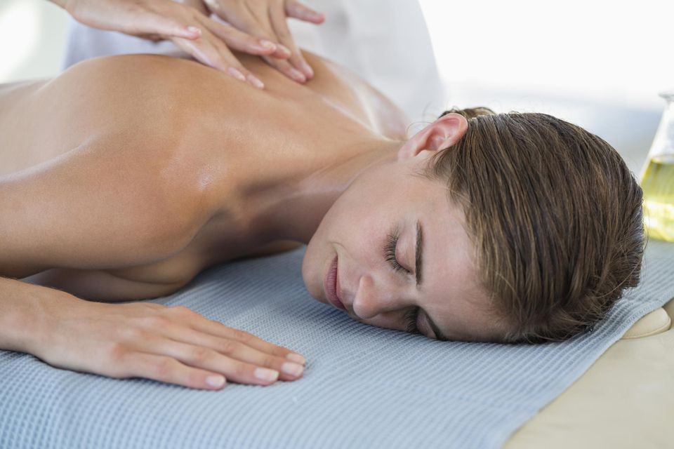 Woman receiving back massage from a massage