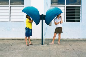 Women using local telephone booths in Cienfuegos, Cuba