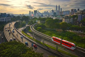 Kuala Lumpur monorail and traffic going into city