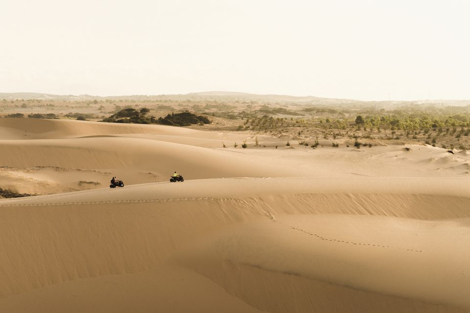 Two quad bikes exploring the white sand dunes of Mui Ne