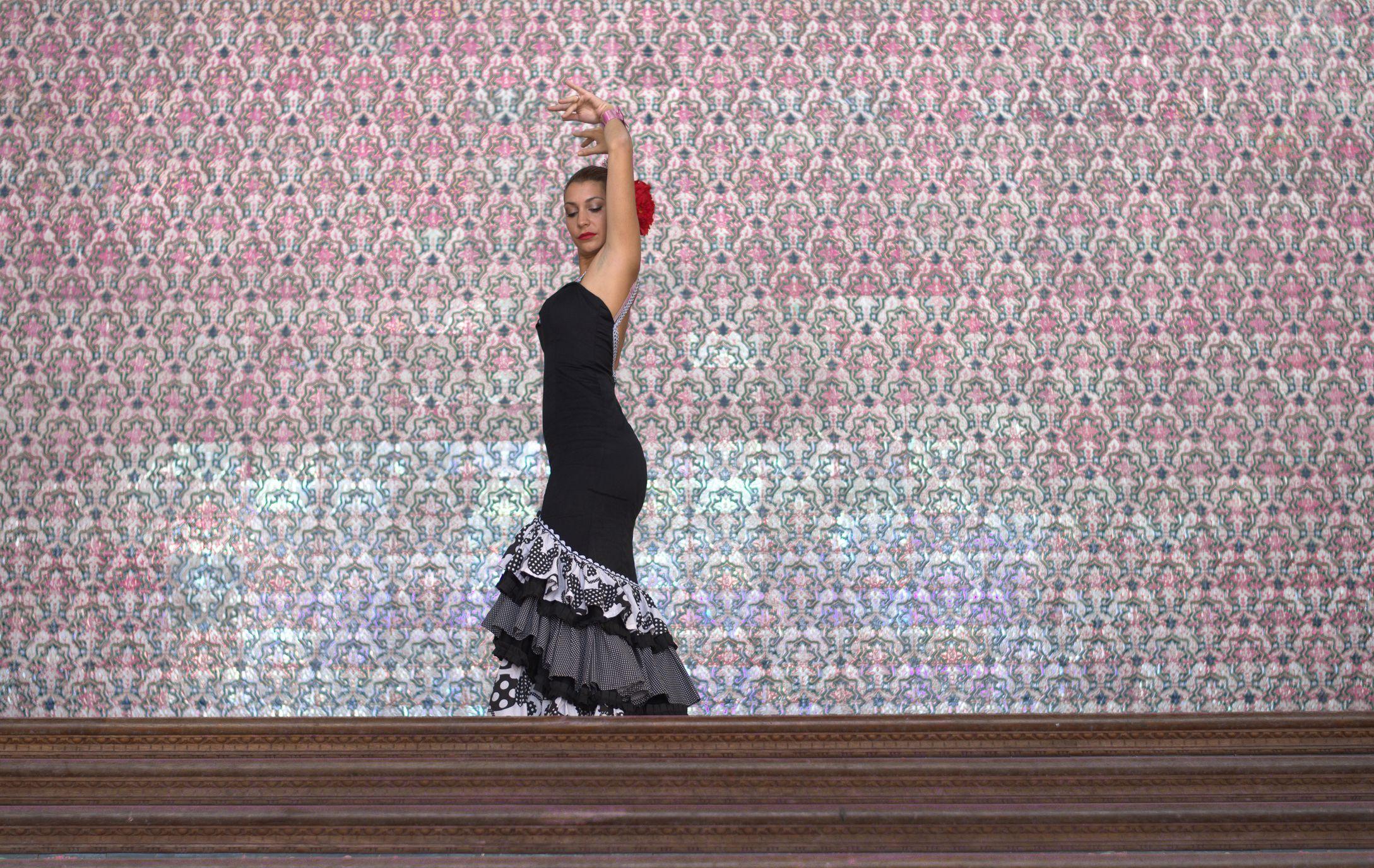 Beautiful woman dances the flamenco in Madrid