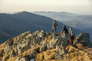 Mother with her sons descending from Buteanu peak in Fagaras Mountains, Romania