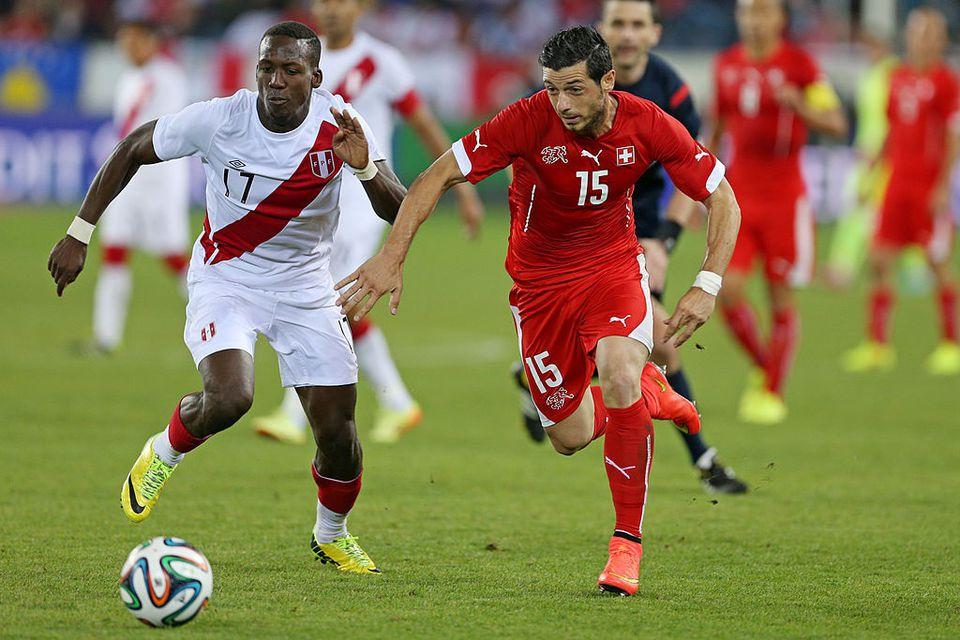 A soccer match between Peru and Switzerland