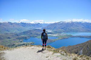 Woman standing on top of Roy's Peak in New Zealand