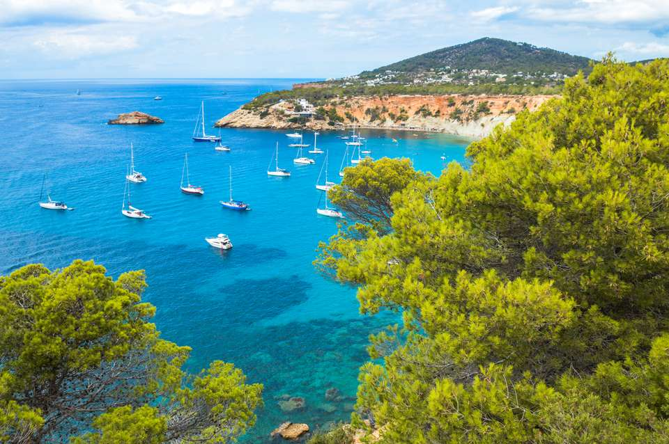 Cala de Sant Vicent with ships in the water