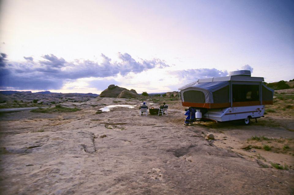 Couple on camping trip enjoying desert views