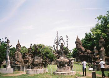 Tourists visiting Wat Xieng Khuan