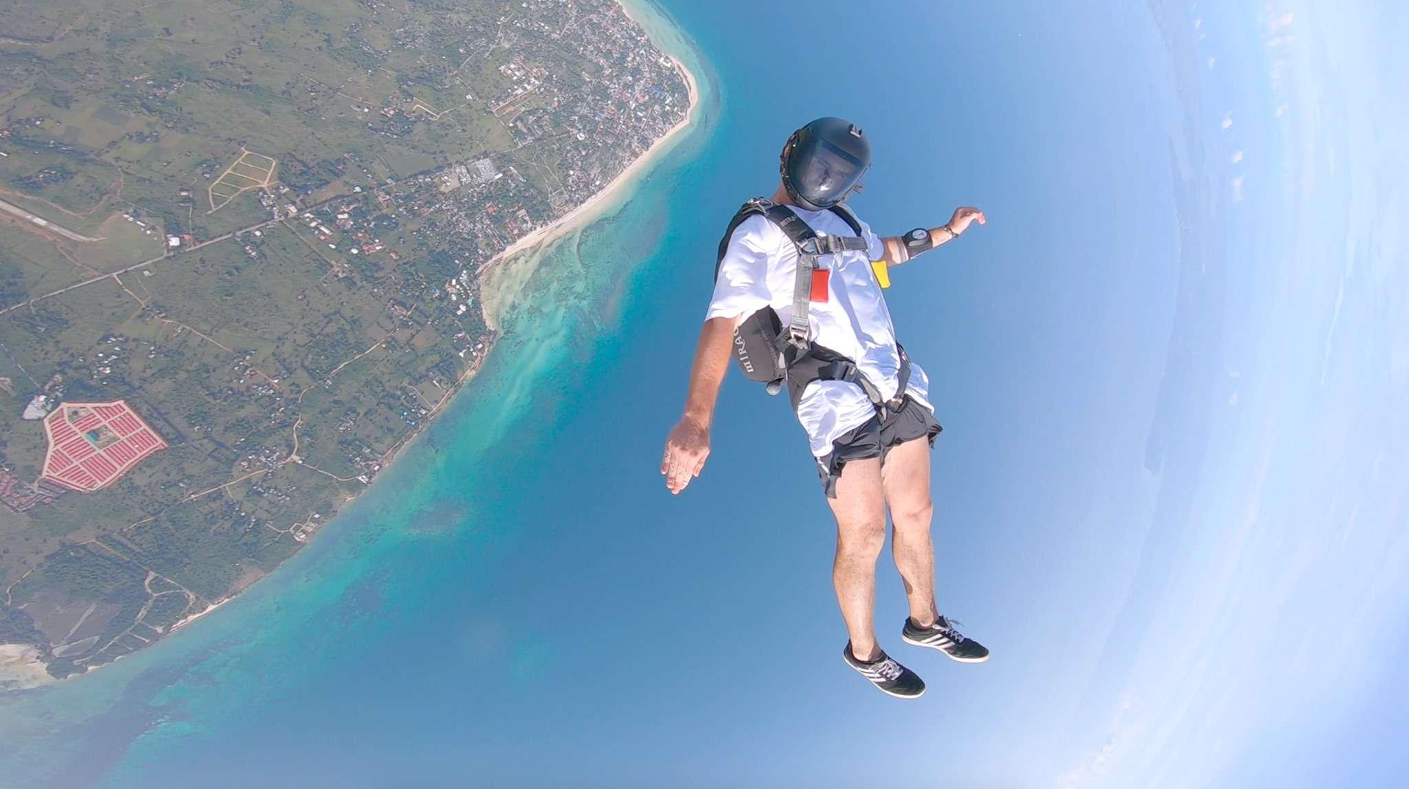 Parachutist skydiving over Cebu