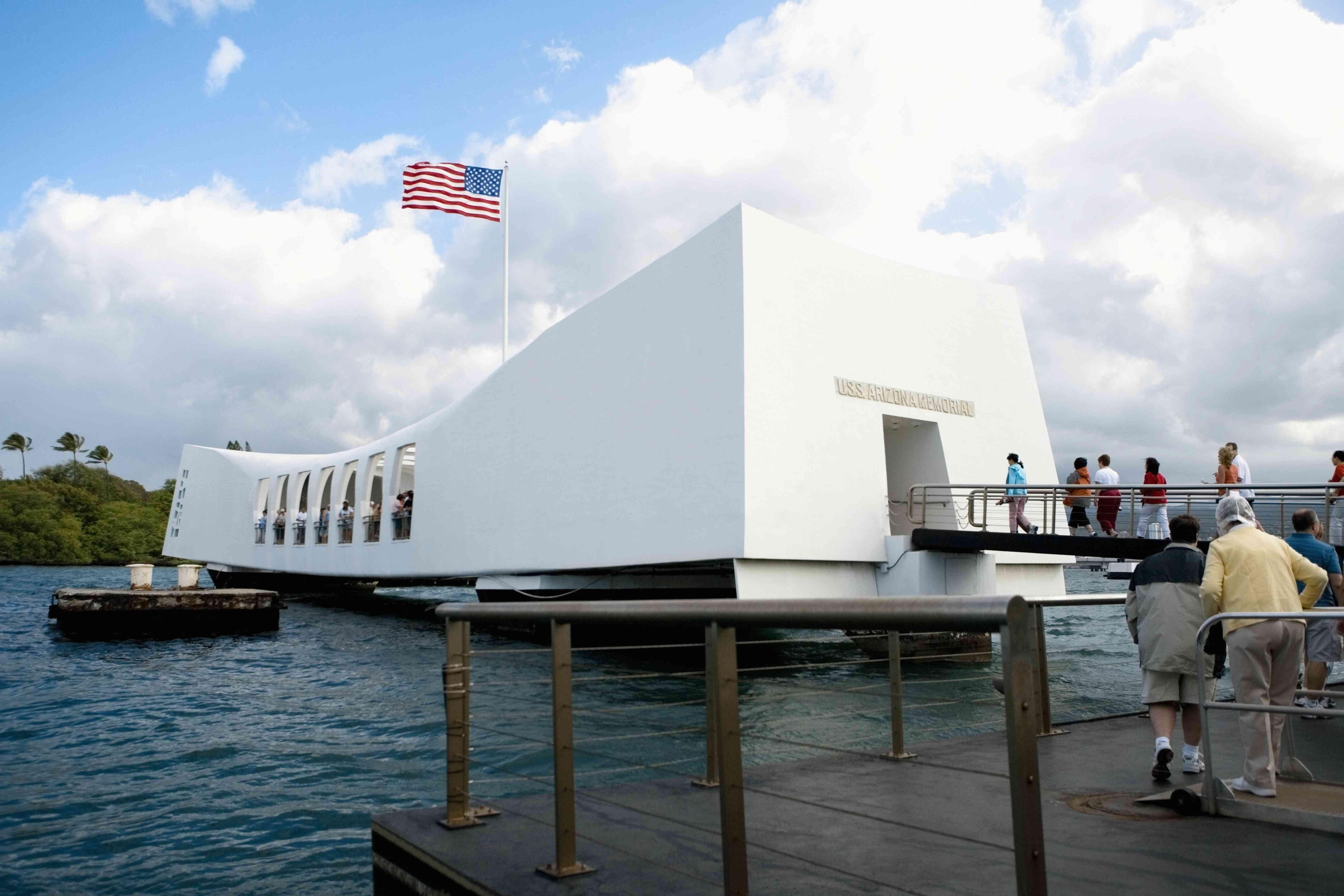 American flag fluttering on a memorial building, USS Arizona Memorial, Pearl Harbor, Honolulu, Oahu, Hawaii Islands, USA