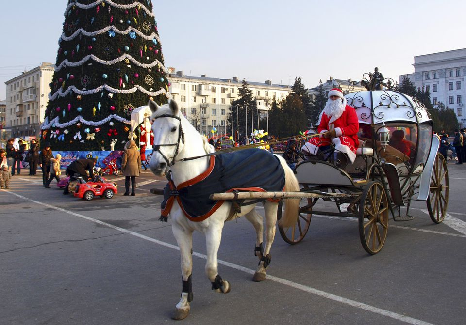 Ded Moroz driving a horse-drawn carriage