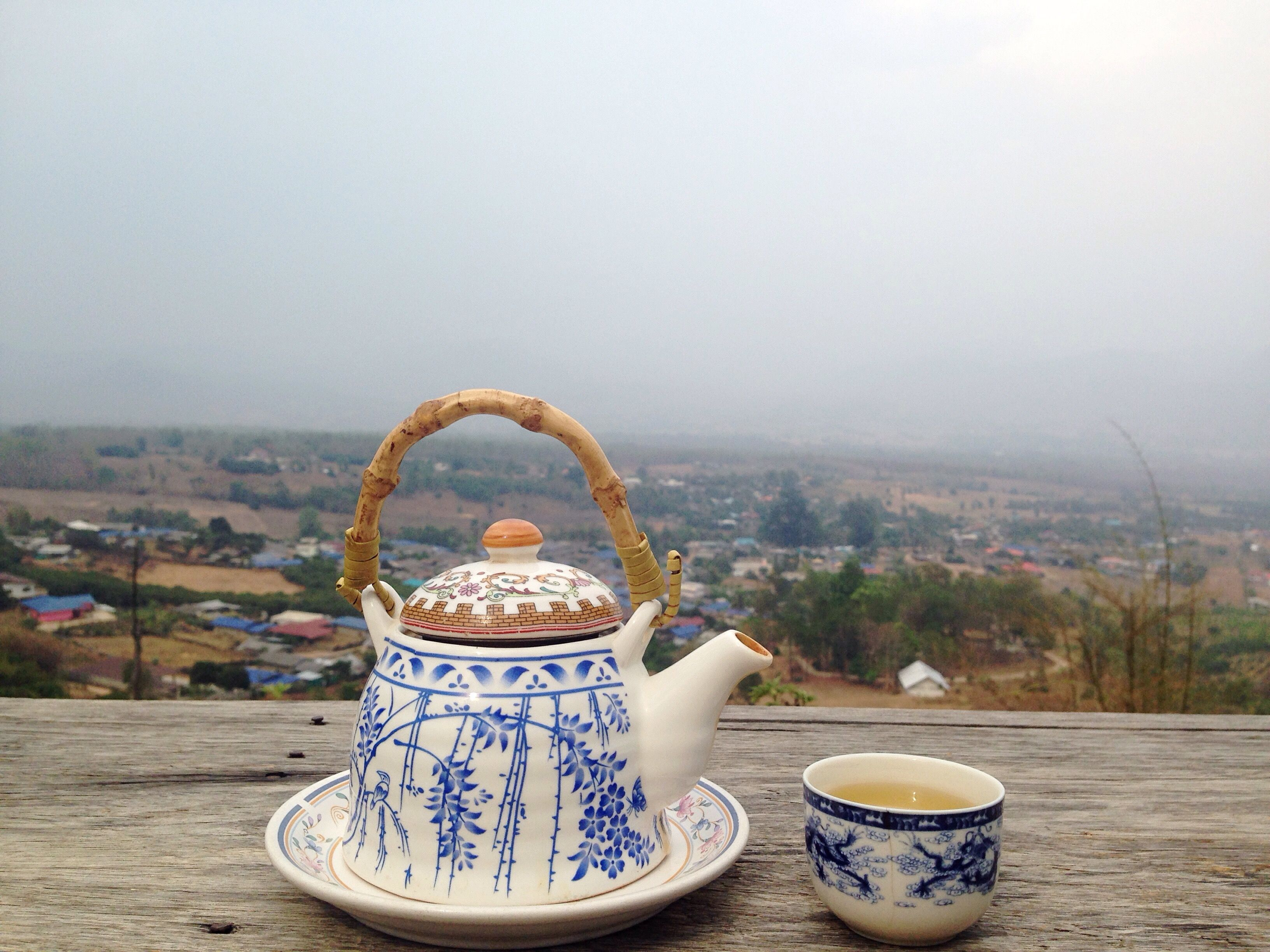 A teapot and cup at the overlook in Pai, Thailand