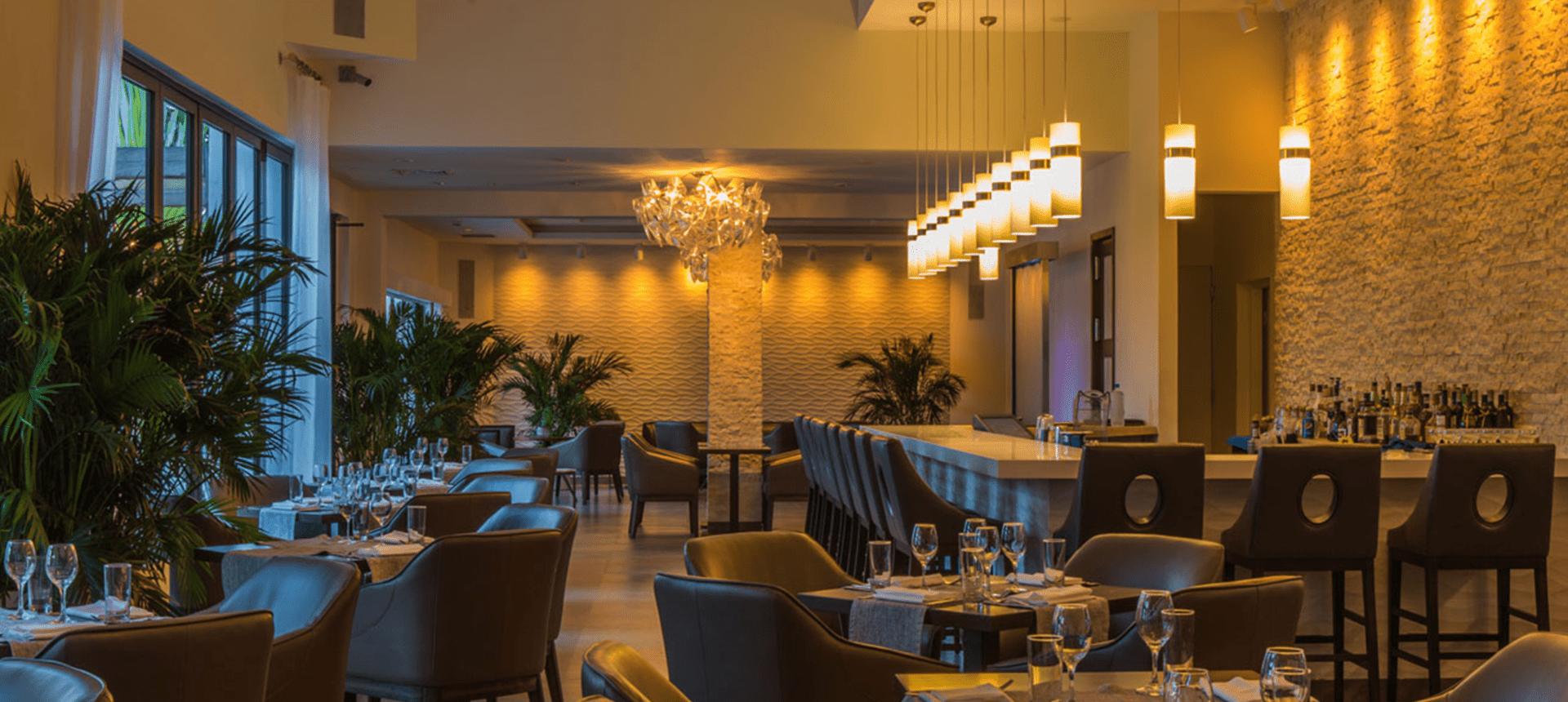 Empty hotel bar with warm lighting