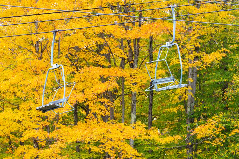 Mountain Chairlifts and Autumn Foliage