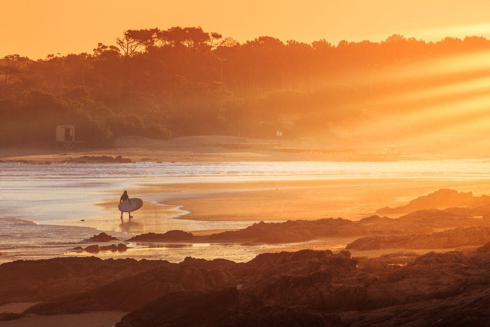 Surfer in sunset in 'La Barra' beach, Punta del Este, Uruguay