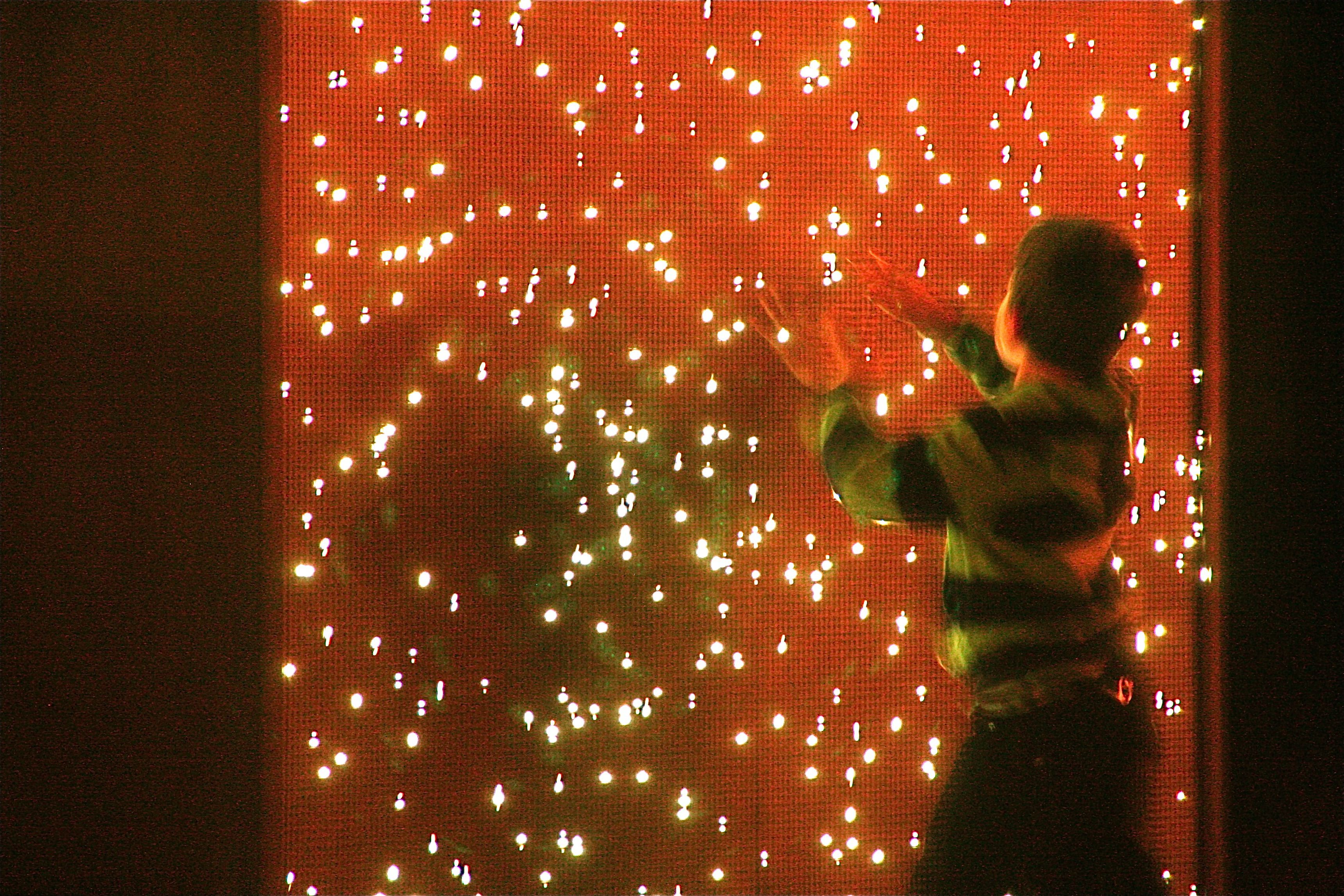 A young visitor enjoys an interactive installation as part of