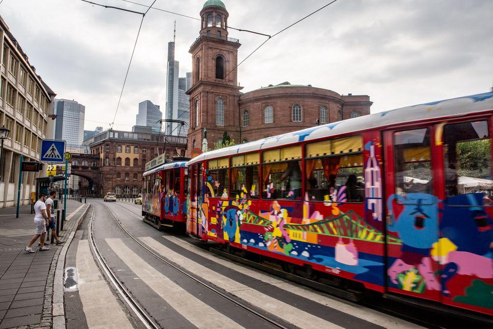 A tram speeding down a Frankfurt street