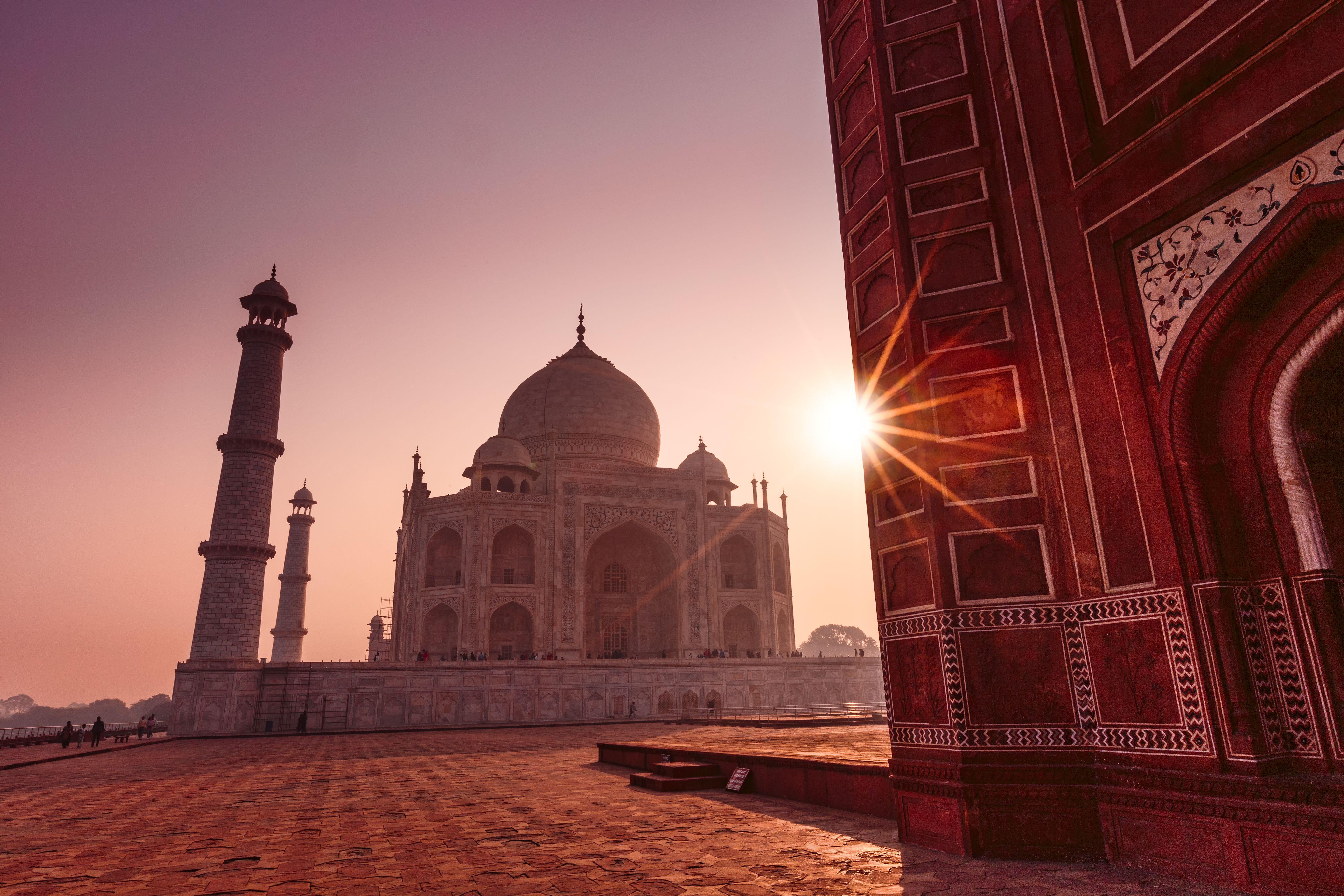 The sun behind the Taj Mahal in India
