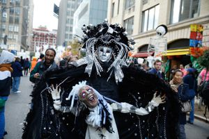 Participants in costume attend the 42nd Annual Village Halloween Parade in 2015