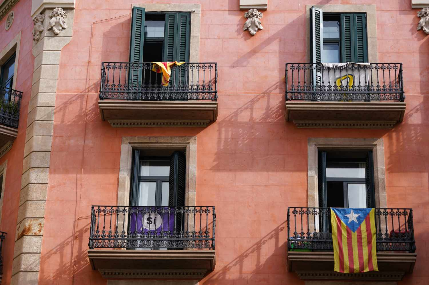 Catalan flags hanging from balconies in Barcelona