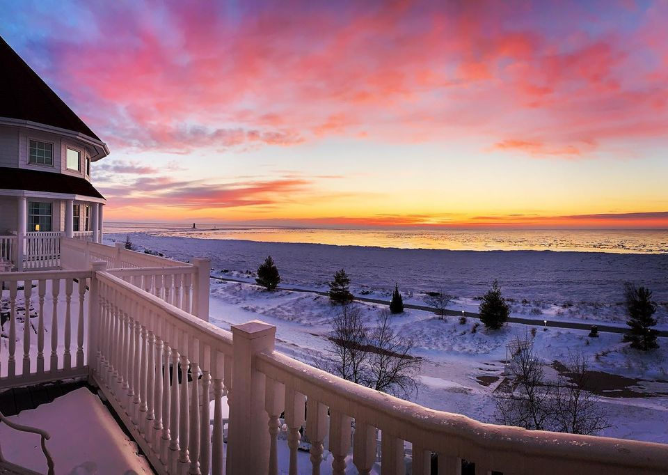 pink and yellow sunsets on winter day in wisconsin