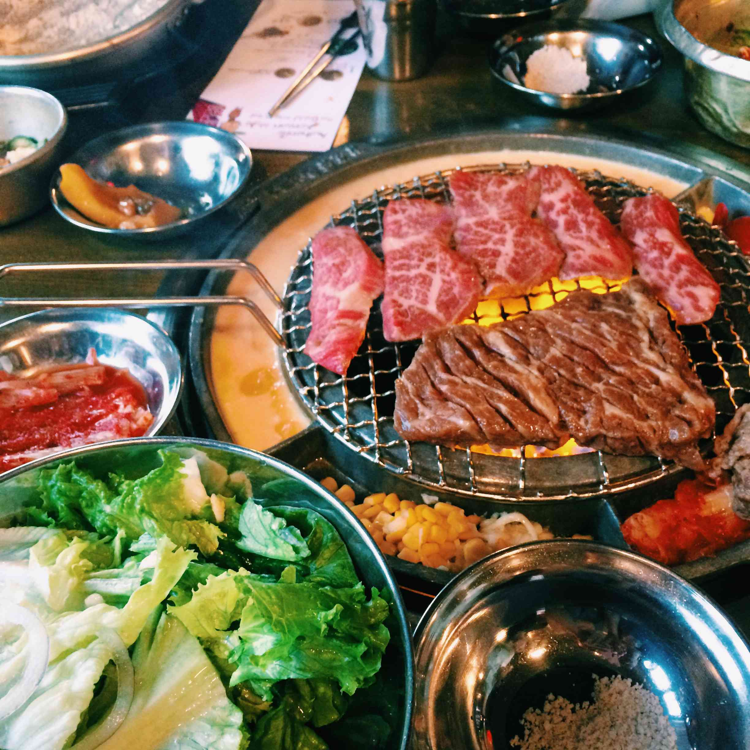 A table of traditional korean BBQ set up