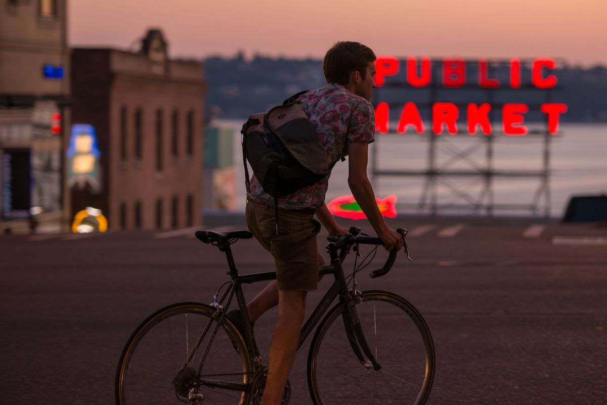 A cyclist rolls through Seattle's Pike Place region with a