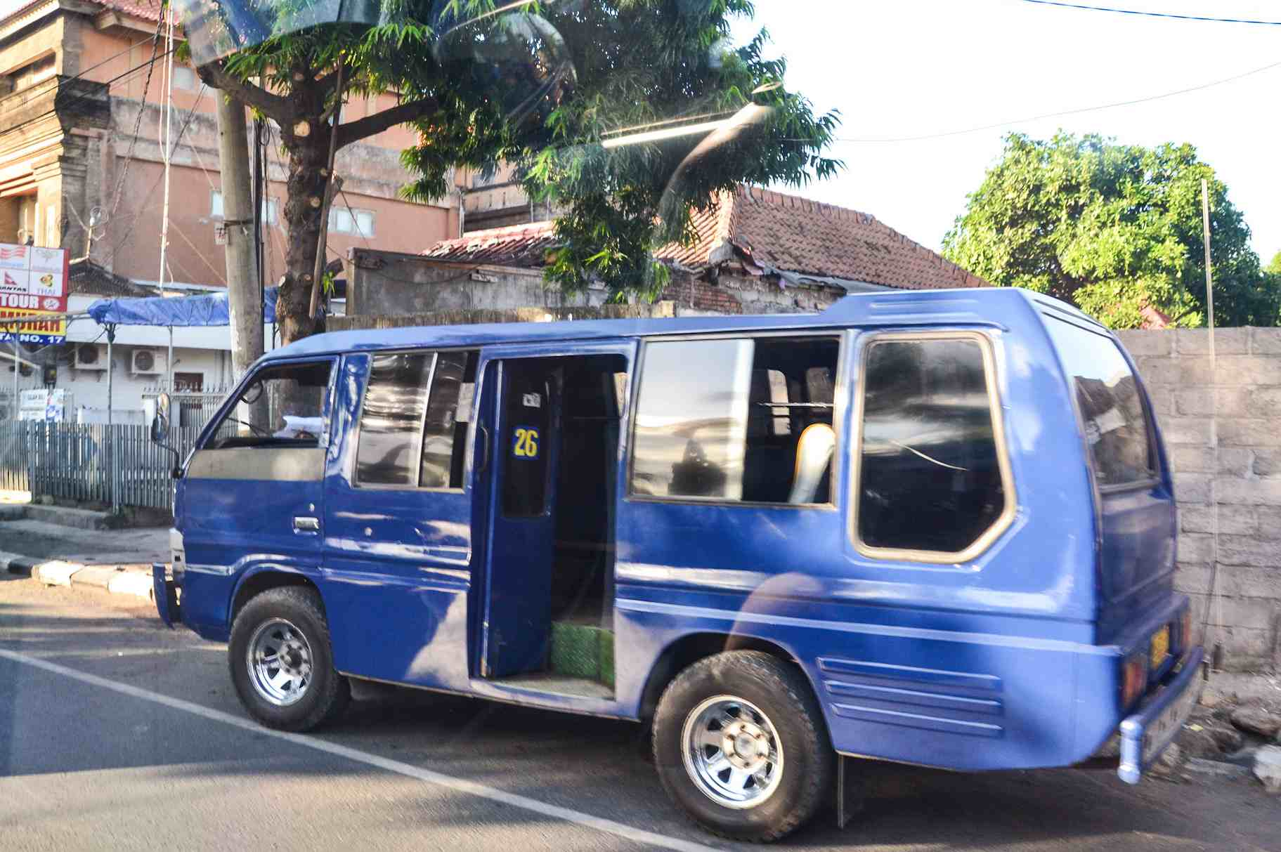 Bemo driving through Bali, Indonesia