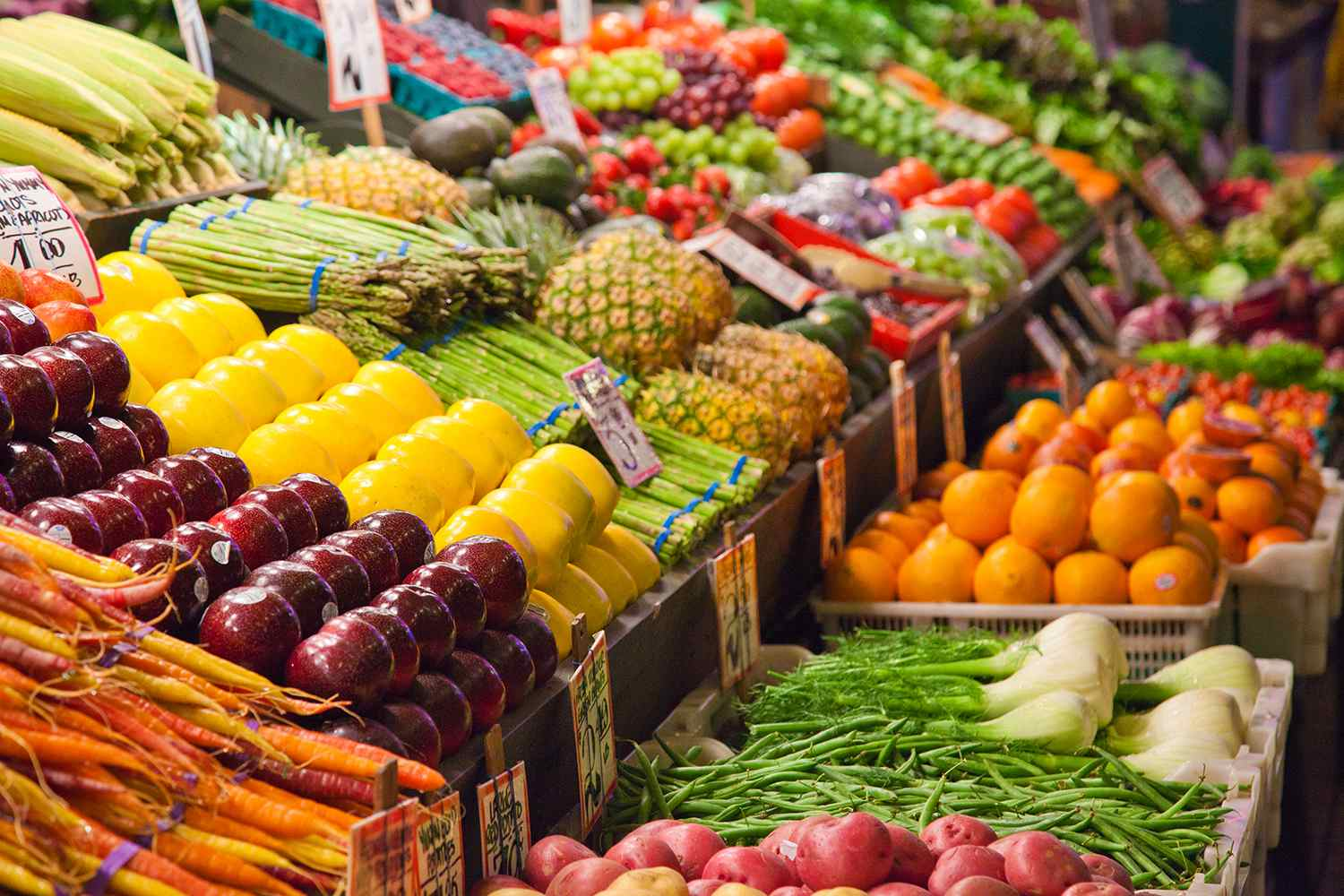 A fruit and vegetable stand at a local market in Seattle, Washington.