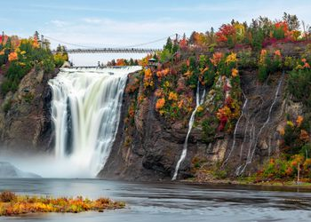 Montmorency Falls and Bridge in autumn with colorful trees