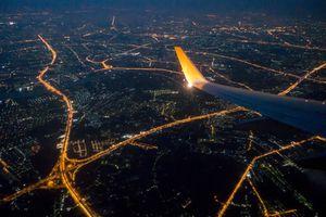 Bangkok city night view via aircraft window