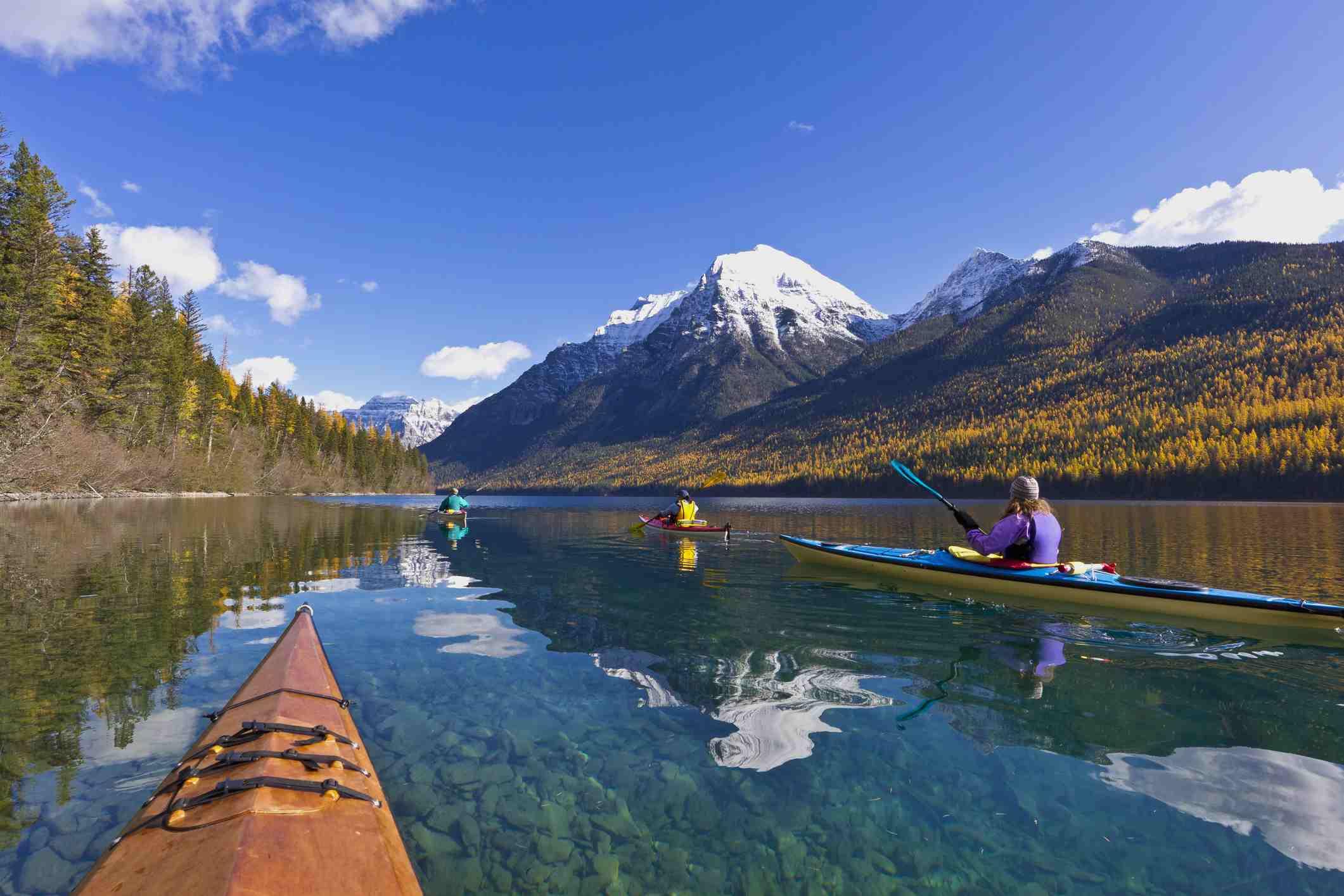 Kayaking on Bowman Lake in autumn, Glacier National Park, Montana, USA