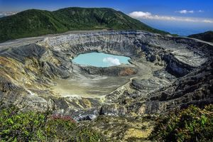 Poas Volcano Crater with its lake and fumarole, in Costa Rica. An active stratovolcano that is one of the most important tourist destinations in the Central American country.