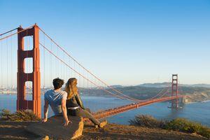 A couple admiring the Golden Gate Bridge