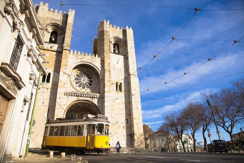 Portugal, Cathedral with tram passing by