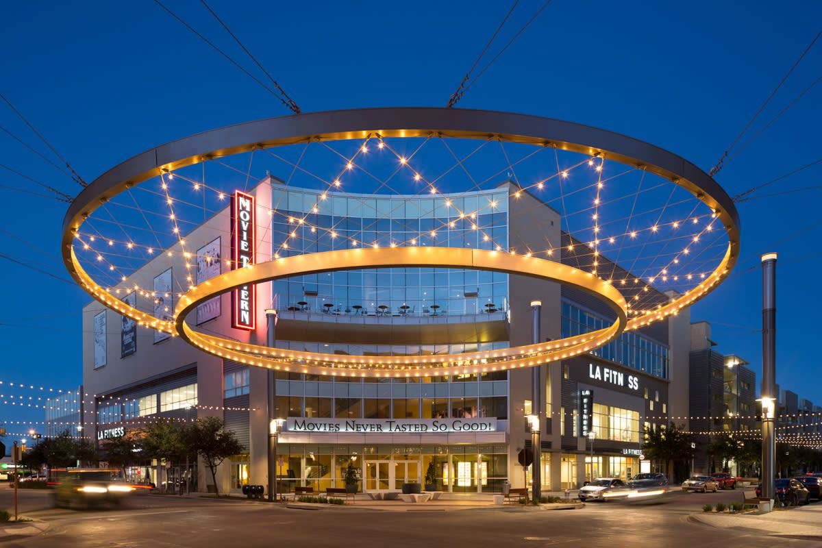 large outdoor light fixture infront of a movie theater on Fort Worth's Crockett Row at night