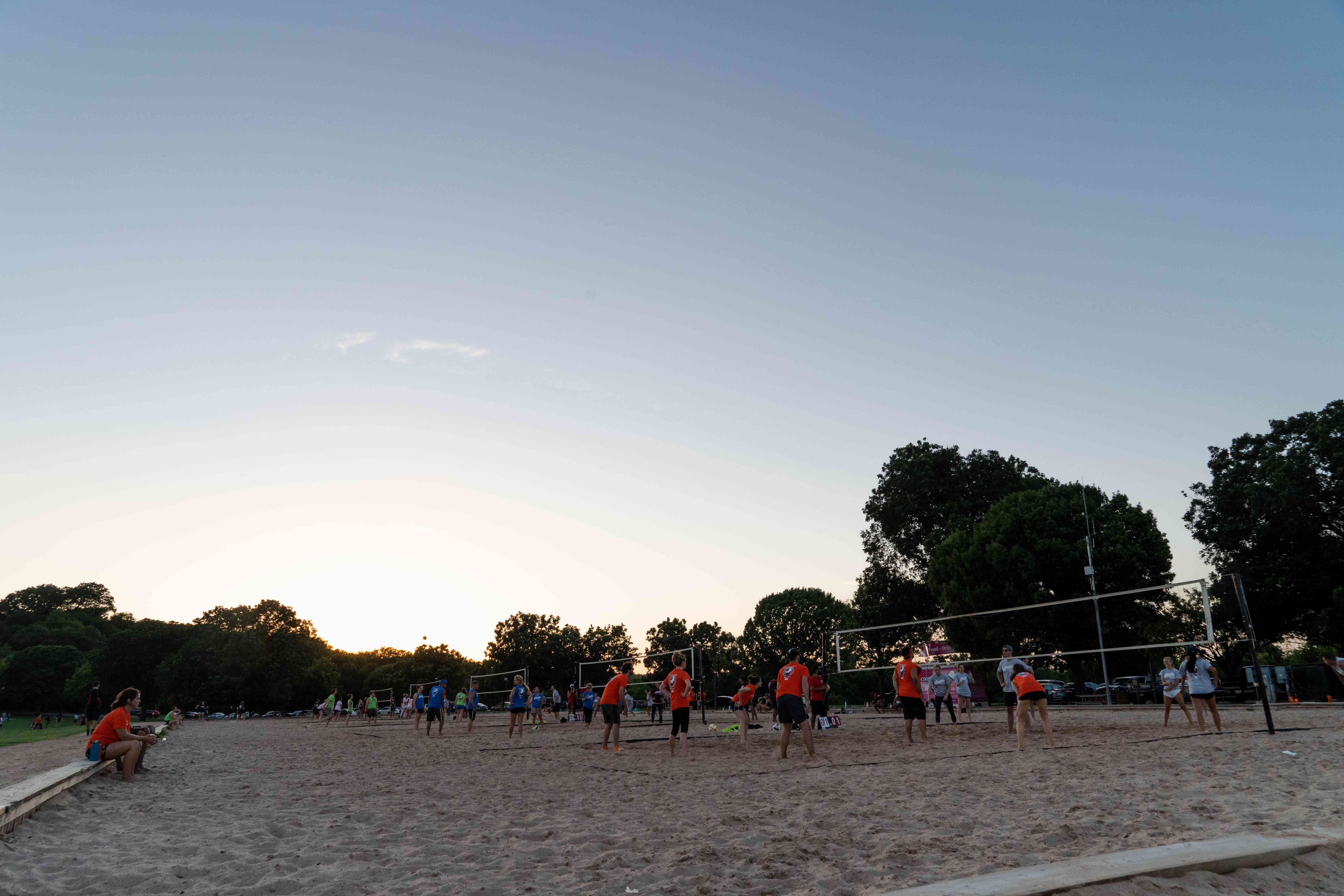 People playing volleyball in Zilker Park