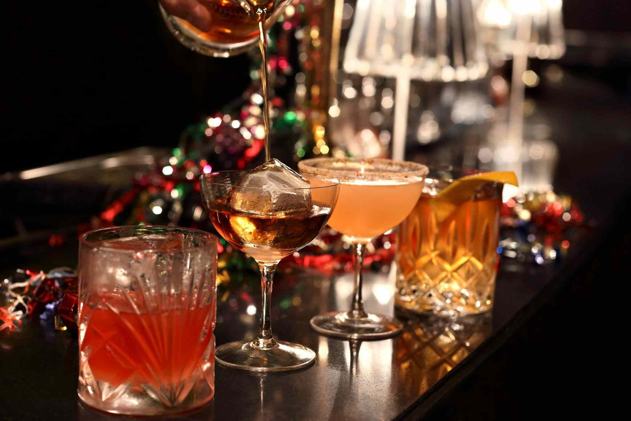 A row of specialty cocktails from Manhattan