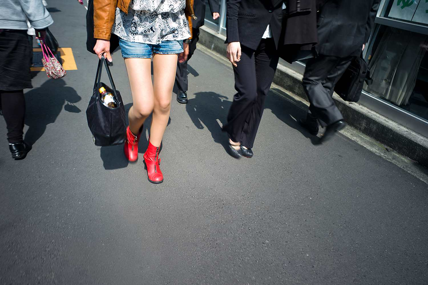Woman with red boots