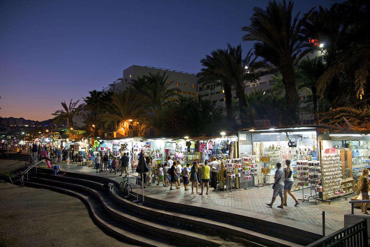 People walking and shopping on beachside promenade