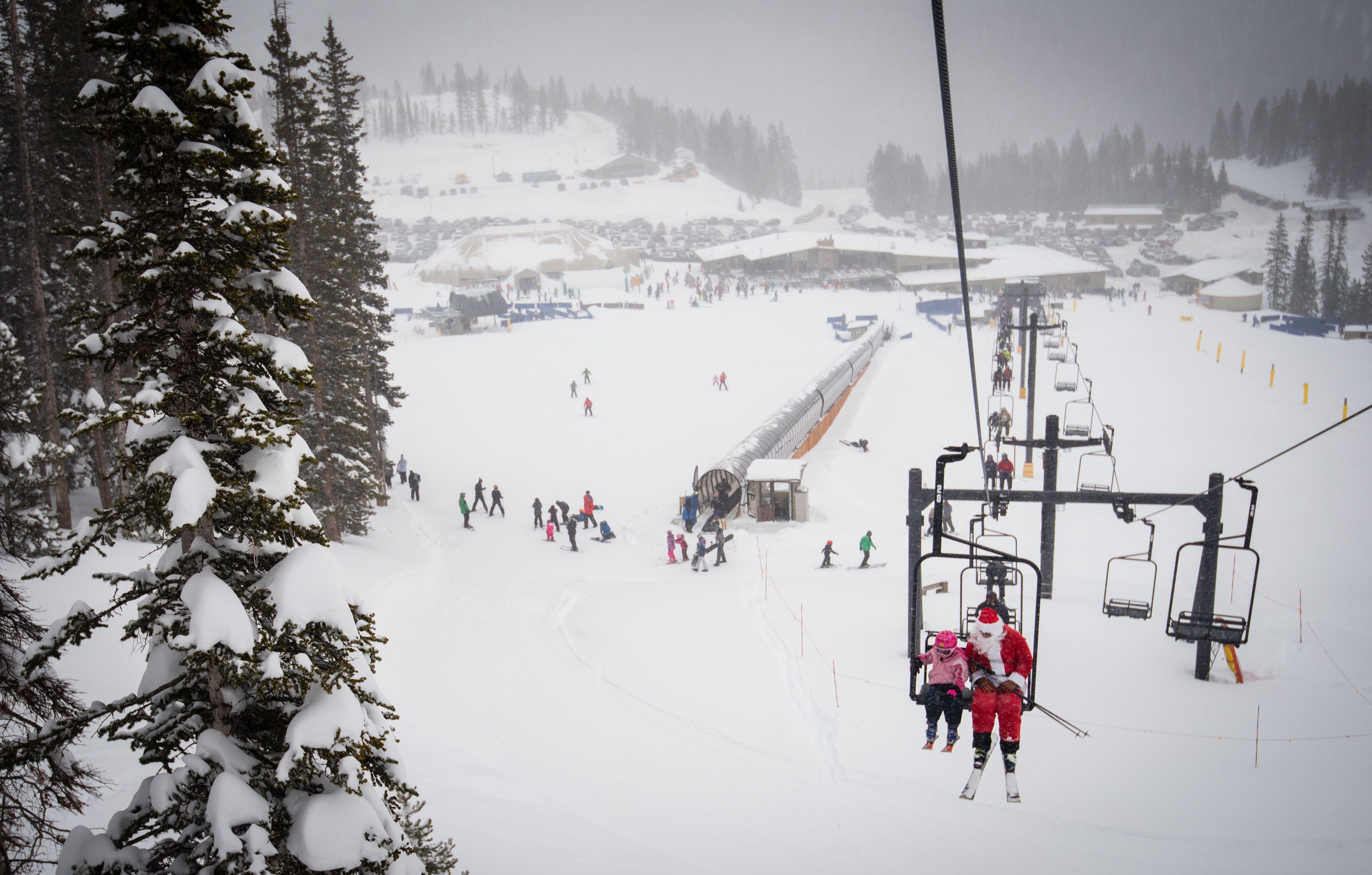 A girl and Santa on the ski lift at Monarch Ski Resort