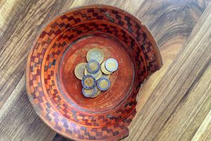 Mexican peso coins in bowl.