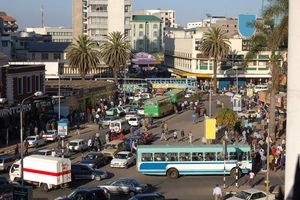 An elevated view of downtown Nairobi with traffic and public buses visible